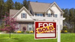 home with sold sign in great neighborhood image